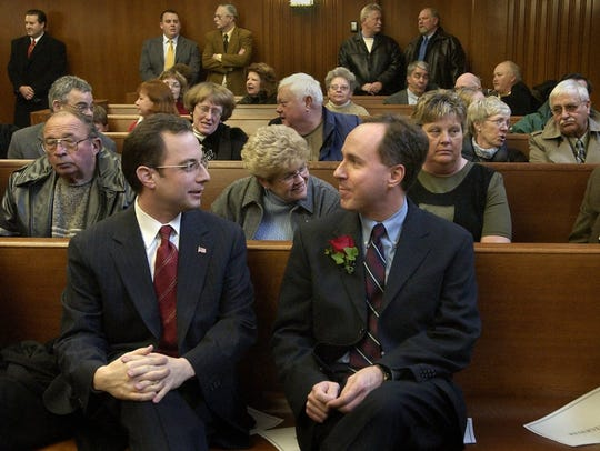 Robin Vos (right) talks with longtime friend and college