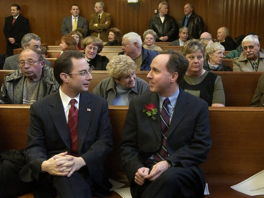 Robin Vos (right) talks with longtime friend and college roommate Reince Preibus before being sworn in as state representative in 2004.