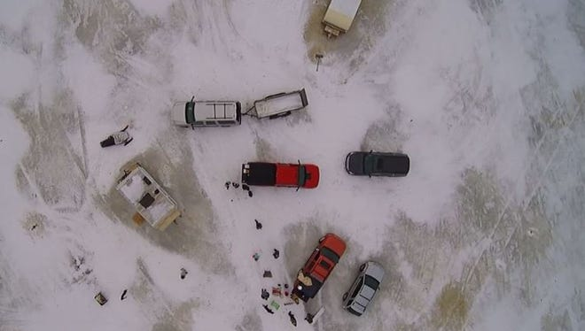 "Screenshot from ""Ice Fishing Lake Wausau in February"" video by Daniel Paul"