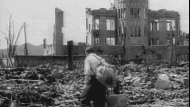 A man walks through the rubble near the remains of the Hiroshima Chamber of Commerce and Industry building, (now the Atomic-Bombing Dome), in this image made from newly recovered footage of the western Japanese city shot just weeks after the Aug. 6, 1945, atomic bombing by the United States.