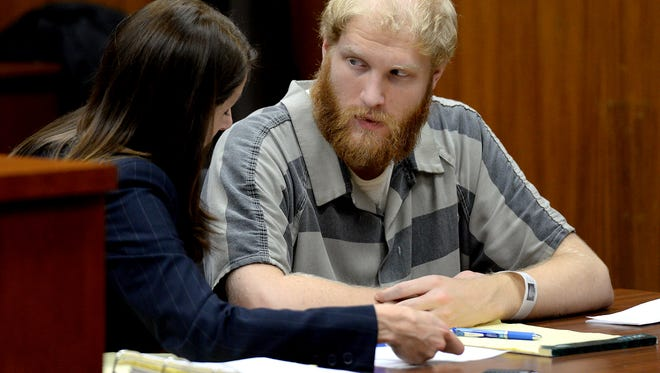 Grant Taylor talks with his attorney Stacia Buchanan after a preliminary hearing Thursday, December 3, 2015 in Lansing, Mich. Taylor is charged in the September death of Rodeman, who was killed when he was hit by a truck while collecting donations for the Fill the Boot campaign.