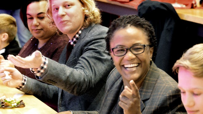 York City Mayor Kim Bracey laughs as she and  samples food from Restaurant Week participants at Central Market during last year's event. She was joined by state Rep. Kevin Schreiber and former York City Poet Laureate Carla Christopher, background. (Bill Kalina - bkalina@yorkdispatch.com)