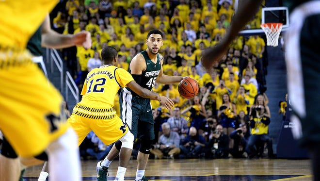 Spartans guard Denzel Valentine gets the offense set for a play in the first half against Michigan Saturday, Feb. 6, 2016 at Crisler Center in Ann Arbor.