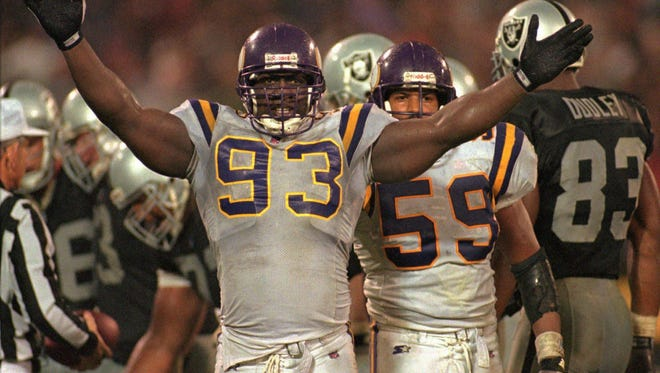 The Minnesota Vikings defensive tackle John Randle (93) gestures to the crowd in 1996 at the Oakland, Calif., Coliseum.