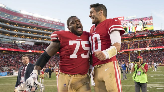 San Francisco 49ers offensive guard Laken Tomlinson (75) celebrates with quarterback Jimmy Garoppolo (10) after the game against the Tennessee Titans at Levi's Stadium.