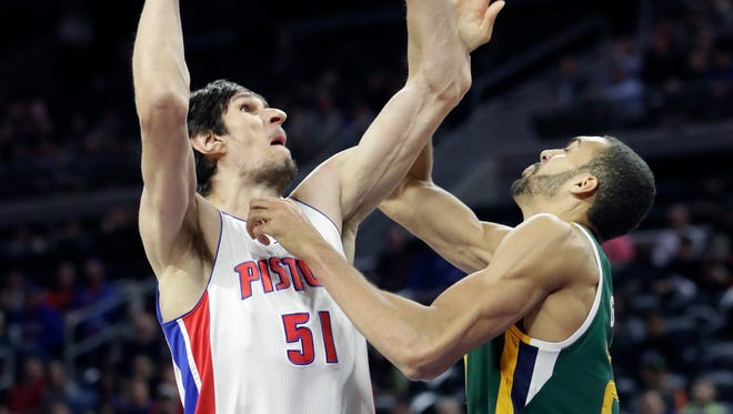 Boban Marjanovic shoots over Jazz center Rudy Gobert during the second half of the Pistons' 97-83 loss at the Palace on March 15, 2017.