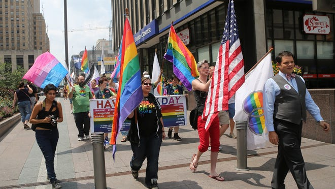 Supporters of gay marriage walk on Fountain Square on Wednesday, Aug. 6, 2014.
