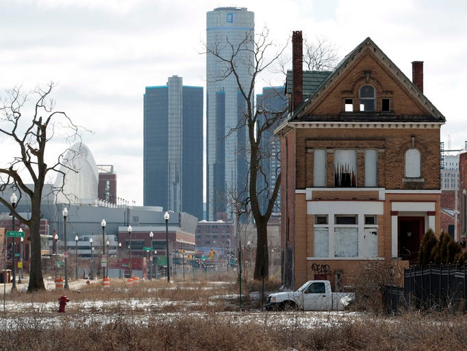 An empty house sits on a lot near downtown Detroit on March 3, 2013. Judge Steven Rhodes ruled on Nov. 7 that Detroit's government can slash more than $7 billion in unsecured liabilities and reinvest $1.4 billion over 10 years in basic services to rehabilitate the city.