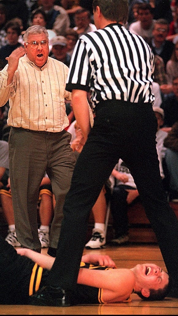 Former Mitchell star Mike Miller grimaces after a clash for a rebound as his coach, Gary Munsen, approaches the referee. Miller went on to college fame at Florida and in the NBA. Munsen died Jan. 12, 2016.