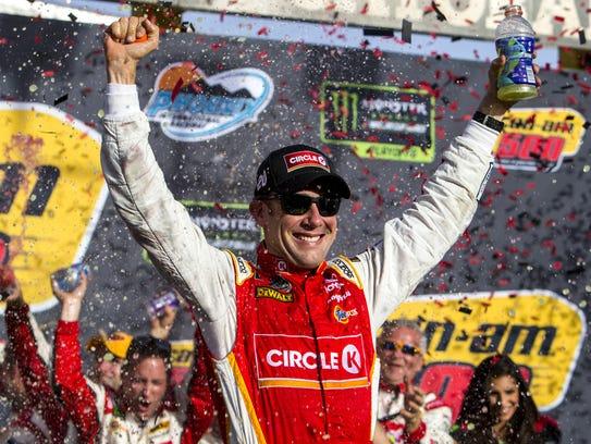 Matt Kenseth celebrates after winning the Can-Am 500 on Sunday at Phoenix Raceway in Avondale.