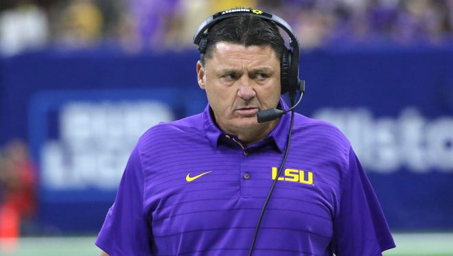 LSU coach Ed Orgeron walks on the sideline during his team's game against Brigham Young in 2017.