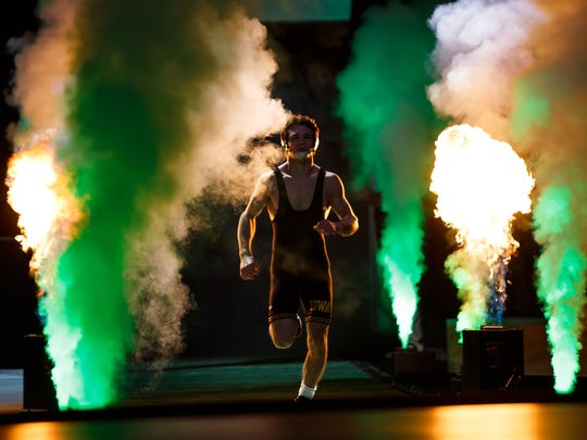 Iowa's Thomas Gilman runs out to the mat before the 2016 NCAA championship bout in New York City.
