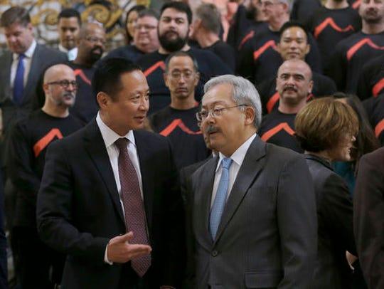 San Francisco Mayor Ed Lee, right, speaks with Public