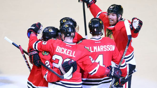 Game 6: Chicago Blackhawks right wing Marian Hossa (81) is congratulated by teammates after scoring a goal against the Anaheim Ducks in the second period.