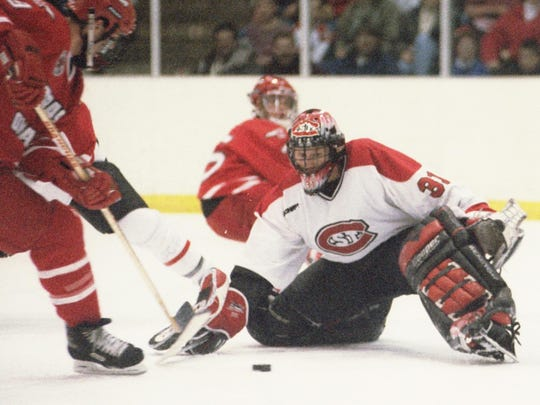 St. Cloud State goaltender Brian Leitza makes a save