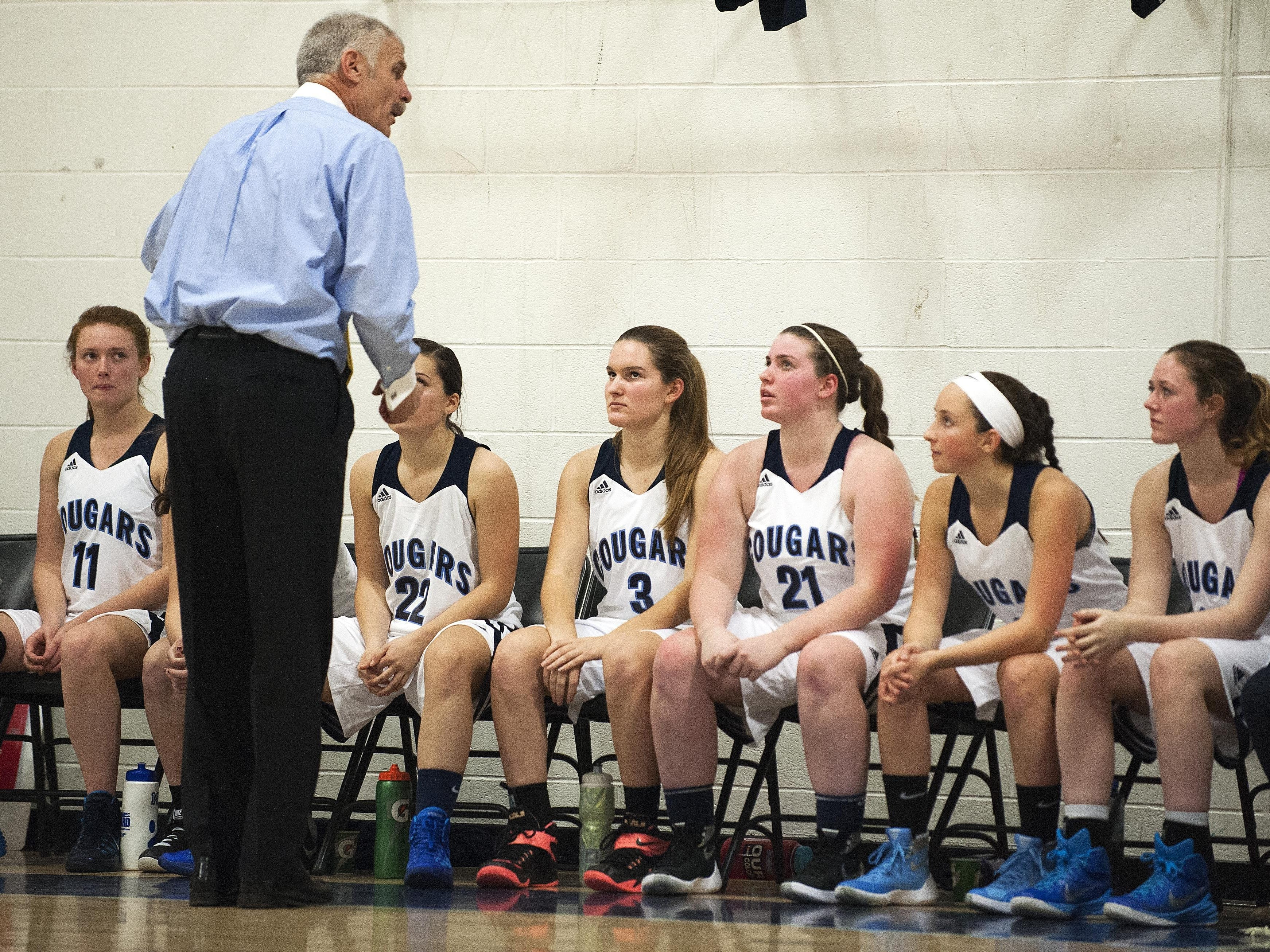 Mount Mansfield head coach Marty Derda talks to the his team on the bench during the girls basketball game between the Rice Green knights and the Mount Mansfield Cougars at MMU High School on Friday night December 4, 2015 in Jericho.