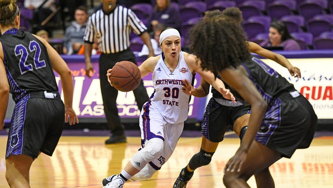 Northwestern State's Beatrice Attura drives against the Central Arkansas defense.