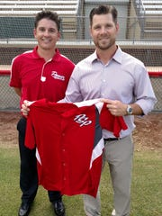 Palm Springs Power president Andrew Starke (right) holds a jersey while announcing Casey Dill (left) as the team's new manager Wednesday.