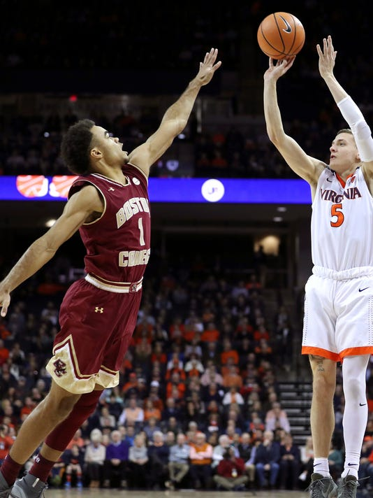 Virginia's Kyle Guy (5) shoots over Boston College's Jerome Robinson (1)  in the first half of an NCAA college basketball game Saturday, Dec. 30, 2017, in Charlottesville, Va. (Zack Wajsgras /The Daily Progress via AP)