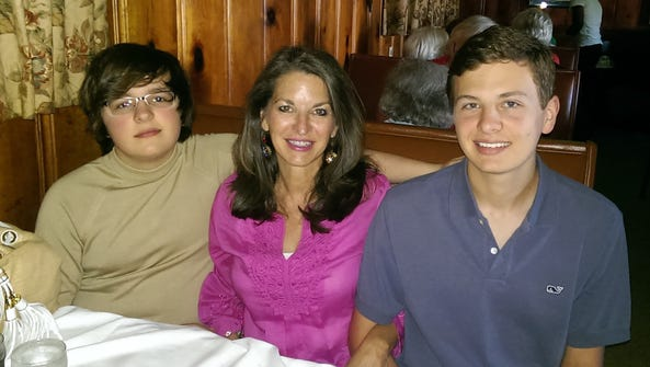Donna Echols' youngest son, Jake Mabus, from left,