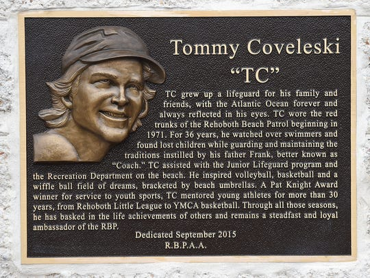 The plaque honors Tommy Coveleski, a Rehoboth Beach native and 36-year member of the Rehoboth Beach Patrol.
