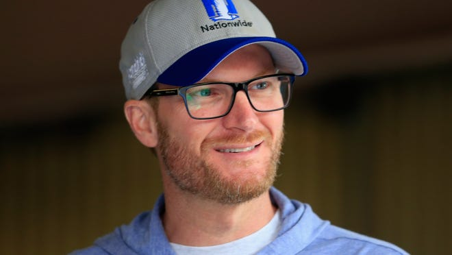 DOVER, DE - OCTOBER 01:  NASCAR Sprint Cup Series driver Dale Earnhardt Jr. stands in the garage area during practice for the NASCAR Sprint Cup Series Citizen Solider 400 at Dover International Speedway on October 1, 2016 in Dover, Delaware.  (Photo by Chris Trotman/Getty Images) ORG XMIT: 673491449 ORIG FILE ID: 611741176