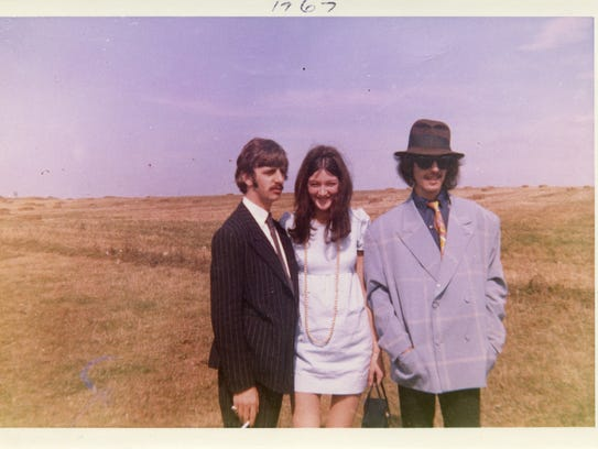 Freda Kelly, center, with Ringo Starr and George Harrison
