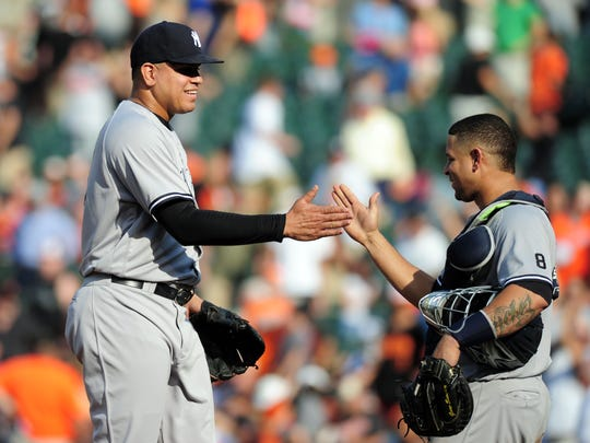 Yankees pitcher Dellin Betances high-fiving catcher Gary Sanchez after a win against Baltimore at Camden Yards on Sept. 4. Betances lost his arbitration case to the Yankees on Saturday, Feb. 18, 2017. The club will pay $3 million in 2017 to Betances, who requested $5 million.