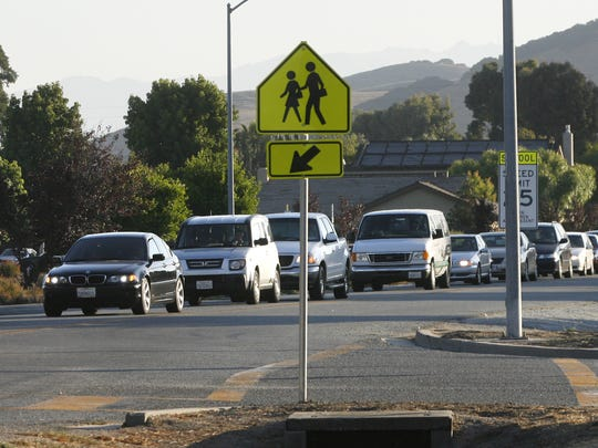 Commuters use of Portola Drive in Toro Park to leapfrog morning traffic on Highway 68. Traffic backed up on Portola Drive in Toro Park in front of Toro Park School at 7:40 in the morning .