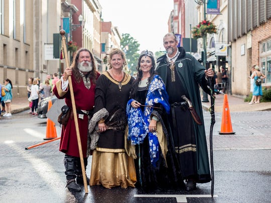 Far left: Chris and Mia Pugh in full garb portraying two of the founders of Hogwarts — Godric Gryffindor and Helga Hufflepuff.