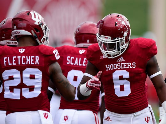 Indiana Hoosiers wide receiver Camion Patrick (6) and linebacker Dawson Fletcher (29) share a high five routine during warm up before the game at Memorial Stadium on Sept. 5, 2015.
