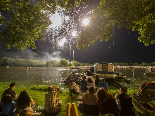 People watch the Festival Foods' Fourth of July Fireworks display at Menominee Park last year during Sawdust Days.