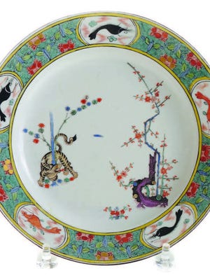 This Meissen Kakiemon-style plate auctioned for $6,500. It was made about 1740 and has the crossed swords mark in blue.