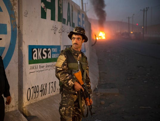 Afghan police officer securing foreign compound