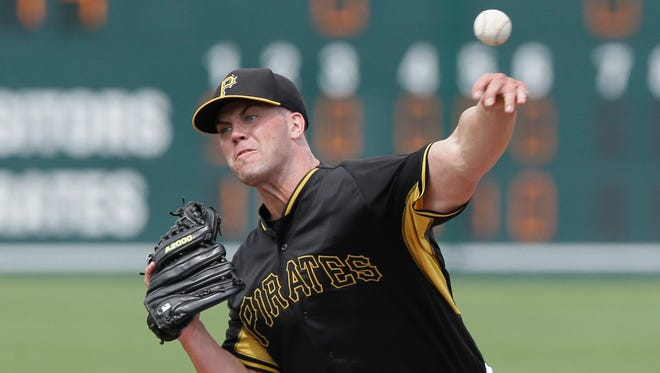 Pittsburgh Pirates' pitcher Clayton Richard throws during the seventh inning of a spring training exhibition baseball game against the Atlanta Braves in Bradenton, Fla., Thursday, March 26, 2015. (AP Photo/Carlos Osorio)