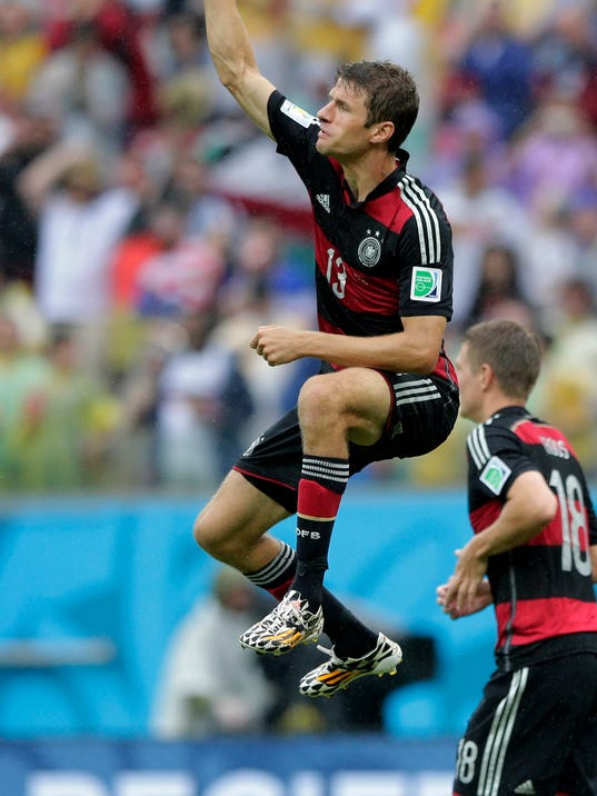 Germany's Thomas Mueller celebrates scoring the opening goal during the group G World Cup soccer match between the USA and Germany at the Arena Pernambuco in Recife, Brazil, Thursday, June 26, 2014. (AP Photo/Matthias Schrader)