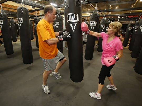 Don Wurtzel, left, and his wife Terry, both age 58 from Saline, go through a workout at the Title Boxing Club franchise in Ann Arbor on Friday Jan 11, 2013.  JULIAN H. GONZALEZ/Detroit Free Press
