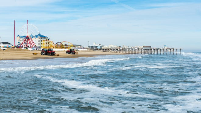 Crews work to clear sand in the Ocean City Inlet Parking Lot from the winter storm in Ocean City on Monday, Jan 25.