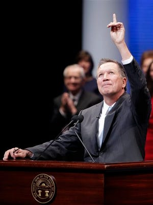 Ohio Gov. John Kasich reacts to a standing ovation after being sworn in for his second term Monday, Jan. 12, 2015, in Columbus, Ohio. (AP Photo/Jay LaPrete)