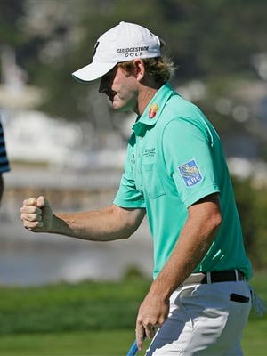 Brandt Snedeker reacts after making a birdie on the fifth green of the Pebble Beach Golf Links during the final round of the AT&T Pebble Beach National Pro-Am golf tournament Sunday, Feb. 15, 2015, in Pebble Beach, Calif.