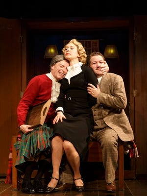 "In this image released by the O and M Company, Arnie Burton, from left, Brittany Vicars and Robert Petkoff appear during a performance of ""39 Steps,"" at The Union Square Theatre in New York. (AP Photo/The O and M Company, Joan Marcus)"