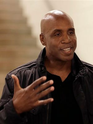 Former San Francisco Giants player Barry Bonds gestures during an interview prior to the baseball game between the Washington Nationals and the San Francisco Giants, Thursday, Aug. 13, 2015, in San Francisco. (AP Photo/Ben Margot)