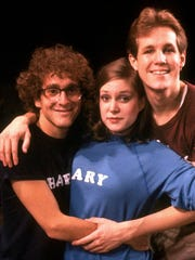 "In this image released by O&M/DKC, Lonny Price, left, Ann Morrison, and Jim Walton, right, castmembers in the Stephen Sondheim 1981 musical, ""Merrily We Roll Along,"" pose in New York. The show closed after just 16 Broadway performances."
