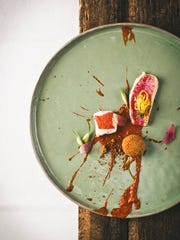 This April 2016 photo provided by Hisa Franko shows a dish by chef Ana Ros at her restaurant, Hisa Franko, in the remote village of Kobarid, in the western part of Slovenia. Ros, 44, and her husband Valter Kramar, 49, have traveled the world, blending global tastes and techniques with ingredients from local fields and barns, and their own vegetable and herb garden. In some ways, Ros' menus reflect the cross-currents that define Slovenia, nestled as it is between Italy, Austria, Hungary and Croatia.