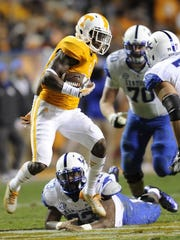 Tennessee defensive back Justin Coleman intercepts a pass meant for Kentucky wide receiver Ryan Timmons (1) during their college football game at Neyland Stadium on Nov. 15, 2014 in Knoxville. UT won 50-16.