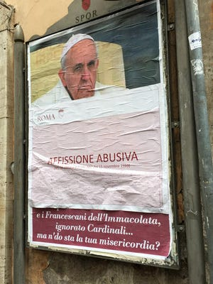 "A paper sheet with writing in Italian reading ""Illigal Posting"" covers an anti-Pope Francis poster in central Rome, Saturday, Feb. 4, 2017. On Saturday, posters appeared around Rome featuring a stern-looking Francis and questioning ""Where's your mercy?"" It referenced the ""decapitation"" of the Knights of Malta, Cardinal Raymond Burke's marginalization and other actions Francis has taken against conservative, tradition-minded groups."