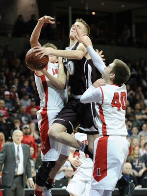 Kittitas' Bailey Gibson (10) drives to the hoop against Liberty during the boys' Class 2B state basketball championship game Saturday, March 4, 2017, in Spokane, Wash. (Tyler Tjomsland/The Spokesman-Review via AP)