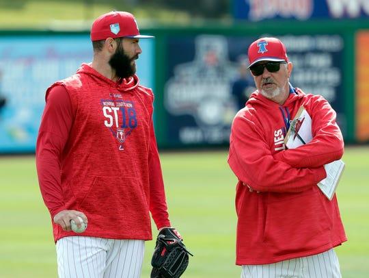 Philadelphia Phillies pitcher Jake Arrieta, left, talks