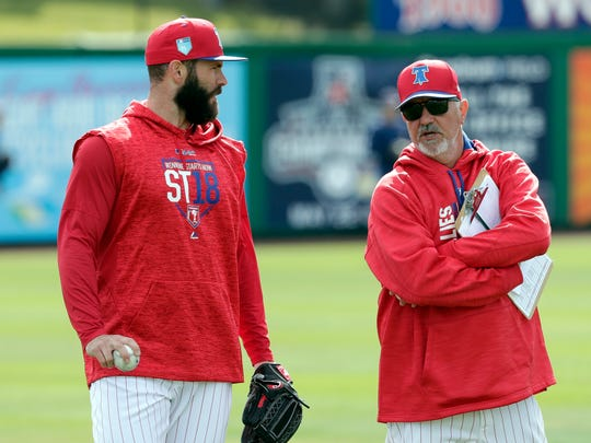 Philadelphia Phillies pitcher Jake Arrieta, left, talks