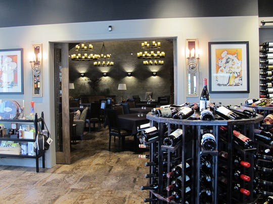 A broad door connects The Cave Bistro & Wine Bar with the Naples Wine Collection retail store in the Galleria Shoppes at Vanderbilt in North Naples.